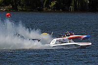 """Joe Kreitzer, GNH-515 """"One Way"""" , Steve Kuhr, GNH-317 """"The Irishman"""" and Cal Phipps, GNH-41  race to the first turn.  (Grand National Hydroplane(s)"""