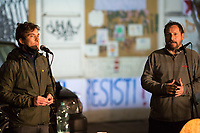 """(From L to R) Alessandro Tiberi (Actor) and Giacomo Ciarrapico (Director).<br /> <br /> Rome, 03/12/2020. Today, the Nuovo Cinema Palazzo Community held a second public assembly (1.) in Rome's San Lorenzo district to protest against the eviction of the """"Nuovo Cinema Palazzo"""" completed by the Italian police forces in the early morning of the 25th of November and to demonstrate against the violent reaction of the Police forces when, in the evening of the same day, a large demo asked to have the chance to hold a public assembly in the square (Piazza dei Sanniti) of the cinema (2.). The public assembly of today saw the participation and the support & solidarity of the representatives of movements, actors, musicians, students, artists, politicians, and citizens of San Lorenzo who told their stories and memories related to the famous Rome's Art and culture occupation (For example, actor Marcello Fonte, Best Actor Award of the 2018 Cannes Film Festival for the film Dogman, was among the first group of occupiers of the Nuovo Cinema Palazzo). The assembly of the 1st December was interrupted due to the bad weather (3).<br /> The Nuovo Cinema Palazzo was occupied the 15th of April 2011, when citizens, movements, workers of the entertainment industry reopened the former """"Palazzo Cinema"""" to prevent the opening of a casino/gambling space. The illegal occupation was intended as a public hub of art, culture, sport and politics, an open place for exchange, discussion, studies, caring and sharing.<br /> <br /> Footnotes & Links:<br /> 1. http://bit.do/fLCpE<br /> 2. Demo And Clashes Against Nuovo Cinema Palazzo Eviction in Rome's San Lorenzo: http://bit.do/fLxgz<br /> 3. http://bit.do/fLCr3<br /> Previous Stories about Nuovo Cinema Palazzo: 14.04.2018 - Nuovo Cinema Palazzo's Concert: """"7 Anni di CasiNò 