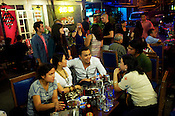 Manila's local art community members enjoying a relaxed evening during an exhibition at the famous bar, Fred's Revolución in Manila Collective at Cubao Expo in Quezon city in Manila, Philippines. Photo: Sanjit Das