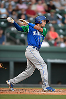 Right fielder Marten Gasparini (24) of the Lexington Legends follows through on a swing during a game against the Greenville Drive on Sunday, September 2, 2018, at Fluor Field at the West End in Greenville, South Carolina. Greenville won, 7-4. (Tom Priddy/Four Seam Images)