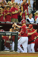May 4, 2011; Phoenix, AZ, USA; Arizona Diamondbacks pitcher Barry Enright is congratulated by Justin Upton (left) after hitting a solo home run in the third inning against the Colorado Rockies at Chase Field. Mandatory Credit: Mark J. Rebilas-