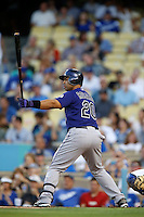 Wilin Rosario #20 of the Colorado Rockies bats against the Los Angeles Dodgers at Dodger Stadium on September 29, 2012 in Los Angeles, California. Los Angeles defeated Colorado 3-0. (Larry Goren/Four Seam Images)