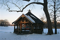 Rustic structure on a frozen pond in Propspect Park that is recreated to emulate the original buildings designed by Frederick Law Olmsted.