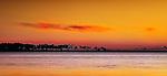 Orange sunset over Gulf of Mexico in Apalachicola, Florida