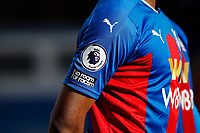 13th March 2021; Selhurst Park, London, England; English Premier League Football, Crystal Palace versus West Bromwich Albion;  Premier League patch next to the Premier League's 'No Room For Racism' in support of anti-racism on the sleeve of Jordan Ayew of Crystal Palace shirt