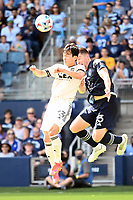 KANSAS CITY, KS - JUNE 26: Moon-hwan Kim #33 Los Angeles FC and Andreu Fontas #3 Sporting KC go up for a header during a game between Los Angeles FC and Sporting Kansas City at Children's Mercy Park on June 26, 2021 in Kansas City, Kansas.
