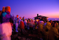 A large group of people enjoy the view of a Haleakala sunrise