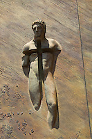 The sculpture on the door of the Basilica of St. Mary of the Angels and the Martyrs in Rome, Italy.