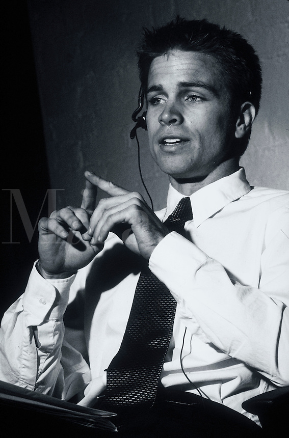 A young executive man with a phone headset.