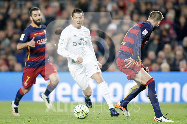 FC Barcelona's Arda Turan (l) and Gerard Pique (r) and Real Madrid's Cristiano Ronaldo during La Liga match. April 2,2016. (ALTERPHOTOS/Acero)