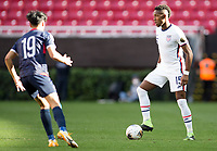 ZAPOPAN, MEXICO - MARCH 21: Andres Perea #15 of the United States turns and moves with the ball during a game between Dominican Republic and USMNT U-23 at Estadio Akron on March 21, 2021 in Zapopan, Mexico.