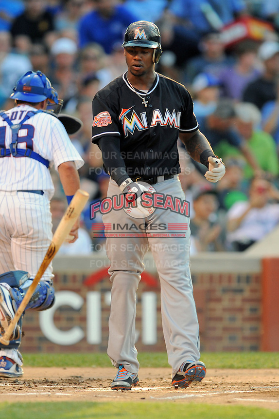 Miami Marlins third baseman Hanley Ramirez #2 reacts to being struck out during a game against the Chicago Cubs at Wrigley Field on July 17, 2012 in Chicago, Illinois. The Marlins defeated the Cubs 9-5. (Tony Farlow/Four Seam Images).