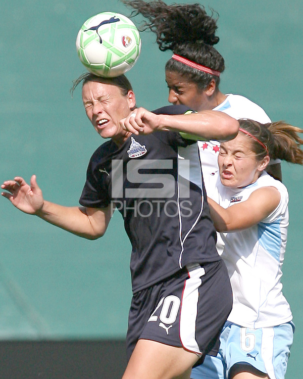 Abby Wambach #20 of Washington Freedom goes for a high ball with Chioma Igwe #12 and Brittany Klein #6 of the Chicago Red Stars during a WPS match at RFK stadium on June 13 2009 in Washington D.C. The game ended in a 0-0 tie.