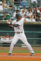 Charleston RiverDogs infielder Abiatal Avelino (19) at bat during a game against the Augusta GreenJackets at Joseph P.Riley Jr. Ballpark on April 15, 2015 in Charleston, South Carolina. Charleston defeated Augusta 8-0. (Robert Gurganus/Four Seam Images)