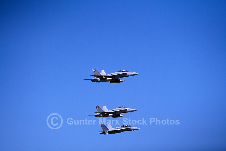 Canadian Forces Boeing CF-18 (aka F/A-18) Hornets Military Aircraft flying in Formation - at Abbotsford International Airshow, BC, British Columbia, Canada