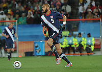 Oguchi Onyewu carries the ball upfield in building an attack. The United States came from a 2-0 halftime deficit to Slovenia to earn a 2-2 draw their second match of play in Group C of the 2010 FIFA World Cup.