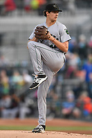 Starting pitcher Garrett Cave (46) of the Augusta GreenJackets delivers a pitch in a game against the Columbia Fireflies on Friday, April 6, 2018, at Spirit Communications Park in Columbia, South Carolina. Columbia won, 7-2. (Tom Priddy/Four Seam Images)