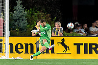 FOXBOROUGH, MA - JULY 7: Alex Bono #25 of Toronto FC takes a goal kick during a game between Toronto FC and New England Revolution at Gillette Stadium on July 7, 2021 in Foxborough, Massachusetts.