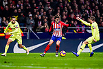 Antoine Griezmann of Atletico de Madrid (C) in action against Arthur Melo of FC Barcelona (R) during the La Liga 2018-19 match between Atletico Madrid and FC Barcelona at Wanda Metropolitano on November 24 2018 in Madrid, Spain. Photo by Diego Souto / Power Sport Images