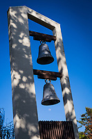 Two bells, one with the raised letters HARD, the other with raised numbers, 1971 and the gibbous moon just below, outside the community center at the Hayward Area Recreation and Parks District's San Felipe Community Park, Hayward, California.