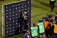 COLUMBUS, OH - DECEMBER 12: Lucas Zelarayan #10 of Columbus Crew holds the MVP trophy after defeating Seattle Sounders FC during a game between Seattle Sounders FC and Columbus Crew at MAPFRE Stadium on December 12, 2020 in Columbus, Ohio.