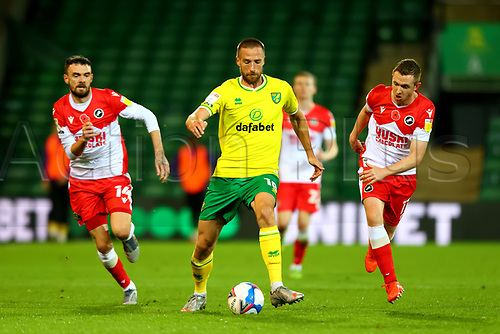 3rd November 2020; Carrow Road, Norwich, Norfolk, England, English Football League Championship Football, Norwich versus Millwall; Marco Stiepermann of Norwich City under pressure from Shane Ferguson and Scott Malone of Millwall