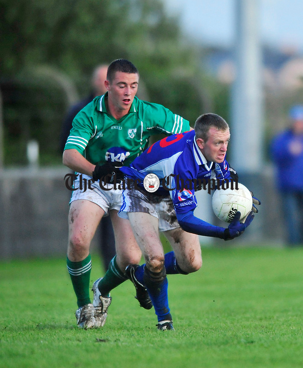 Kilkee's Barry Coleman under pressure from Kilrush's Matthew Moloney. Photograph by Declan Monaghan