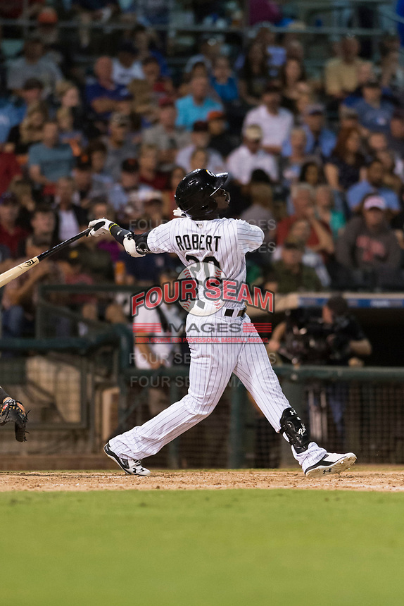 AFL West designated hitter Luis Robert (20), of the Glendale Desert Dogs and Chicago White Sox organization, follows through on his swing during the Arizona Fall League Fall Stars game at Surprise Stadium on November 3, 2018 in Surprise, Arizona. The AFL West defeated the AFL East 7-6 . (Zachary Lucy/Four Seam Images)
