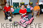 Rehabilitation Assistant Theresa Grimes recreates the Listowel races for elderly residents at the Tralee Community Nursing Unit on Monday. Front centre: Theresa Grimes. Back l to r: Mary O'Shea and Noreen O'Donnell.