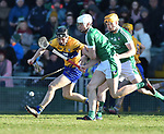 Jack Browne of  Clare  in action against Kyle Hayes of  Limerick during their NHL quarter final at the Gaelic Grounds. Photograph by John Kelly.