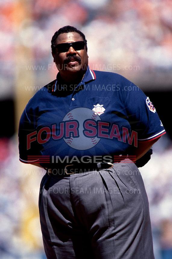 Umpire Eric Greg  participates in a Major League Baseball game at Dodger Stadium during the 1998 season in Los Angeles, California. (Larry Goren/Four Seam Images)