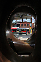Toronto (ON) CANADA - July 2012 - Art Gallery of Ontario on Dundas street. a TTC Tramway seen through :  LARGE TWO FORMS sculpture by henry Moore