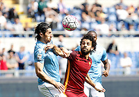 Calcio, Serie A: Lazio vs Roma. Roma, stadio Olimpico, 3 aprile 2016.<br /> Lazio's Milan Bisevac, left, and Roma's Mohamed Salah fight for the ball during the Italian Serie A football match between Lazio and Roma at Rome's Olympic stadium, 3 April 2016.<br /> UPDATE IMAGES PRESS/Isabella Bonotto