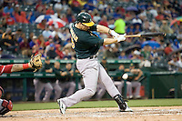 Oakland Athletics outfielder Josh Willingham (16) swings against the Texas Rangers in American League baseball on May 11, 2011 at the Rangers Ballpark in Arlington, Texas. (Photo by Andrew Woolley / Four Seam Images)