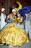 Recife, Brazil. Young follower of Candomble posessed by and dressed to represent Ogum, a Candomble god.