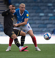 Milton Keynes Dons' Carlton Morris (left) is tackled from behind by Portsmouth's Jack Whatmough (right) <br /> <br /> Photographer David Horton/CameraSport<br /> <br /> The EFL Sky Bet League One - Portsmouth v Milton Keynes Dons - Saturday 10th October 2020 - Fratton Park - Portsmouth<br /> <br /> World Copyright © 2020 CameraSport. All rights reserved. 43 Linden Ave. Countesthorpe. Leicester. England. LE8 5PG - Tel: +44 (0) 116 277 4147 - admin@camerasport.com - www.camerasport.com