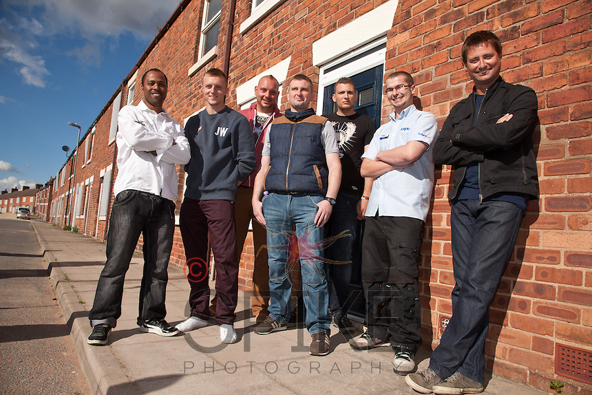 George Clarke (right) of Channel 4's 'Great Property Scandal' visits Pleasley in Mansfield to see how Screwfix have helped out with essential products for the Houses to Homes project.  Pictured from left are armed forces veterans Anthony Hazell, Declan Hill, Steven Van Der Bank, Steven Atkinson, and Kevin Barker with Jamie Pickering of Mansfield Screwfix and George.
