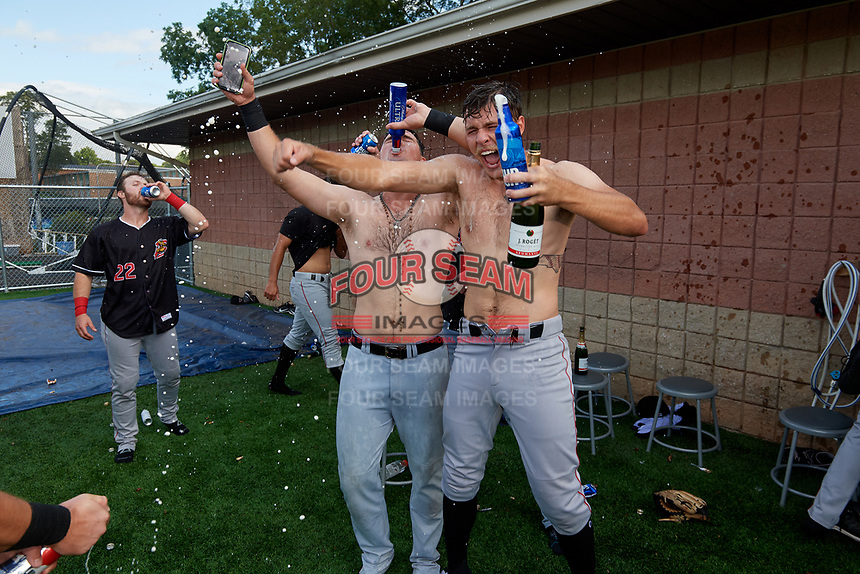 Batavia Muckdogs Nic Ready (3) and Evan Brabrand celebrate after clinching the Pinckney Division Title during a NY-Penn League game against the Auburn Doubledays on September 2, 2019 at Falcon Park in Auburn, New York.  Batavia defeated Auburn 7-0 to clinch the Pinckney Division Title.  (Mike Janes/Four Seam Images)