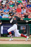 Kane County Cougars left fielder Luis Silverio (14) follows through on a swing during a game against the South Bend Cubs on July 21, 2018 at Northwestern Medicine Field in Geneva, Illinois.  South Bend defeated Kane County 4-2.  (Mike Janes/Four Seam Images)