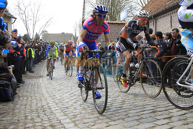 The peloton climbs Molenberg during the 96th edition of The Tour of Flanders 2012, running 256.9km from Bruges to Oudenaarde, Belgium. 1st April 2012. <br /> (Photo by Eoin Clarke/NEWSFILE).