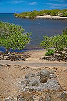 Stone Leaning Post overlooking the Hale o Kapuni Heiau - site of submerged temple dedicated to the shark gods, Puukohola Heiau National Historic Site, Kawaihae, Kohala, Big Island, Hawaii, USA