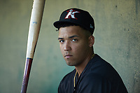 Luis Curbelo (16) of the Kannapolis Intimidators sits in the dugout during the game against the Hickory Crawdads at Kannapolis Intimidators Stadium on May 6, 2019 in Kannapolis, North Carolina. The Crawdads defeated the Intimidators 2-1 in game one of a double-header. (Brian Westerholt/Four Seam Images)