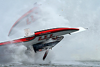 """Frame 46: Jean Theoret, GP-777 """"Steeler"""" (Grand Prix Hydroplane) 2nd Lap, Boat takes off, blows over, comes down on the right sponson breaking it off before coming to a stop upright with the driver unhurt."""
