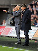 (L-R) Swansea manager Bob Bradley and Watford manager Walter Mazzarri during the Premier League match between Swansea City and Watford at The Liberty Stadium on October 22, 2016 in Swansea, Wales, UK.