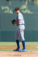 Surprise Saguaros starting pitcher Nate Pearson (20), of the Toronto Blue Jays organization, gets ready to deliver a pitch during an Arizona Fall League game against the Salt River Rafters at Salt River Fields at Talking Stick on October 23, 2018 in Scottsdale, Arizona. Salt River defeated Surprise 7-5 . (Zachary Lucy/Four Seam Images)
