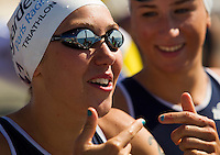 16 SEP 2012 - NICE, FRA - Emmie Charayron of Lagardere Paris Racing talks with team mates before the start of the French Grand Prix triathlon series final stage held during the Triathlon de Nice Côte d'Azur (PHOTO (C) 2012 NIGEL FARROW)