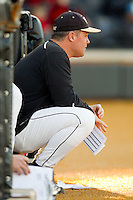 Wake Forest Demon Deacons assistant coach Dennis Healy (31) watches the action from the top step of the dugout during the game against the North Carolina Tar Heels at Wake Forest Baseball Park on March 9, 2013 in Winston-Salem, North Carolina.  The Tar Heels defeated the Demon Deacons 20-6.  (Brian Westerholt/Four Seam Images)