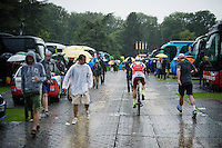 Alexander Kristoff (NOR/Katusha) getting to the race start through the pouring rain<br /> <br /> stage 21: Sèvres - Champs Elysées (109km)<br /> 2015 Tour de France