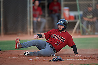 AZL D-backs Wyatt Mathisen (11) slides across home plate during a rehab assignment in an Arizona League game against the AZL Mariners on August 7, 2019 at Peoria Sports Complex in Peoria, Arizona. AZL D-backs defeated the AZL Mariners 4-1. Walston pitched one inning and allowed one earned run while striking out three batters. (Zachary Lucy/Four Seam Images)