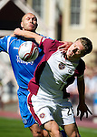Hearts v St Johnstone...14.08.10  .Marius Zaliukas fends off Sam Parkin.Picture by Graeme Hart..Copyright Perthshire Picture Agency.Tel: 01738 623350  Mobile: 07990 594431